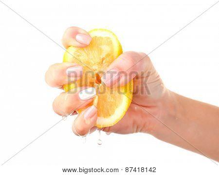Female hand squeezing lemon isolated on white
