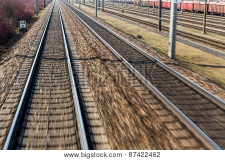 austria, upper austria, linz, wels. seen rails of a railway from a moving train between linz and wels from