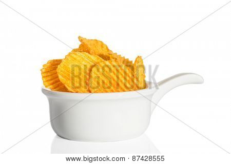 Crinkle cut crisps on a white background