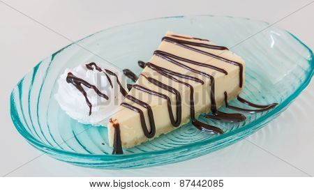 Cheese Cake And Wip Cream With Chocolate Sauce