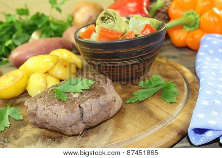 Ostrich Steaks With Baked Potatoes And Parsley