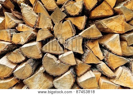 Background of chopped firewood logs