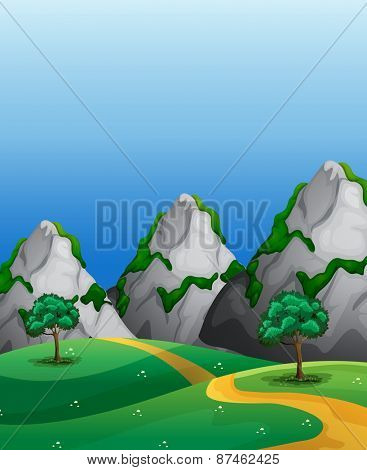 Scene of countryside with mountains and dirt road