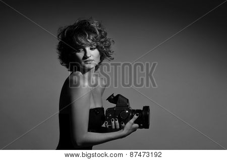 Black and white photo of woman with photocamera ** Note: Soft Focus at 100%, best at smaller sizes