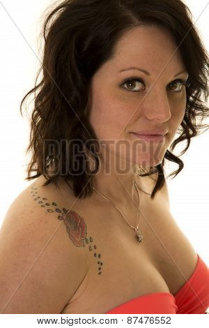Woman In Pink Bikini Top Close And Rose Tattoo On Shoulder