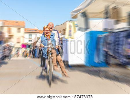 Senior Couple On Bike