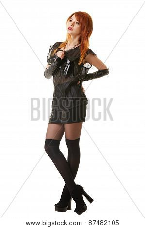 Charming red-haired model posing in gothic clothes