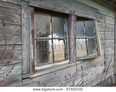 Old Windows in the Side of a Farm Building