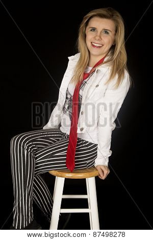 Happy Girl Sitting On Stool Leaning Back Smiling