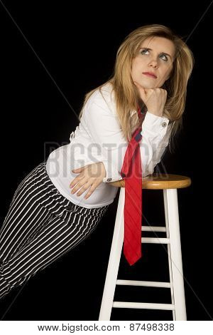 Female Model Leaning On A Barstool Looking Up