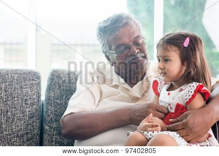 Portrait Indian family at home. Grandparent and grandchild playing together. Asian people living lifestyle. Grandfather and granddaughter.