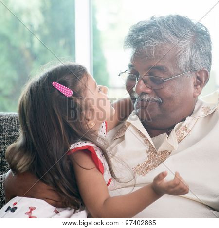Portrait Indian family at home. Grandparent and grandchild close up face. Asian people living lifestyle. Grandfather and granddaughter.