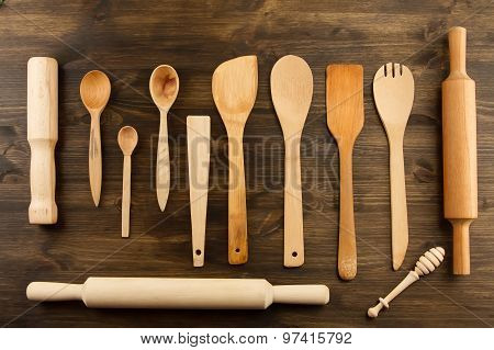 Kitchen Utensils On Wooden Background. Spoon, Mortar, Kitchen Spatula, Rolling Pin