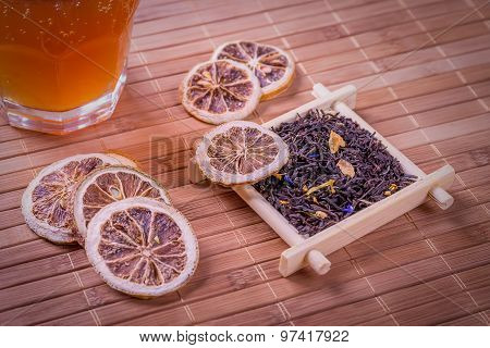 Dried lemon with Earl Grey Tea on a Asian-style wooden backgroun