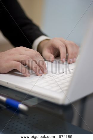 Businessman Sitting Using Laptop