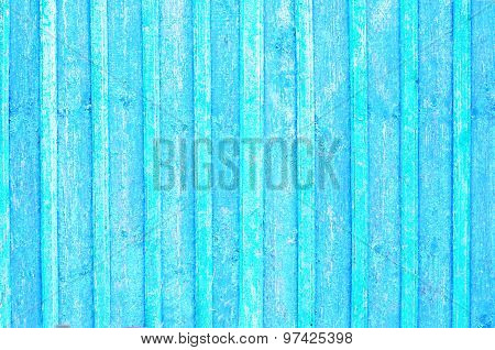 Grungy wood planks wall texture with blue and green peeling paint