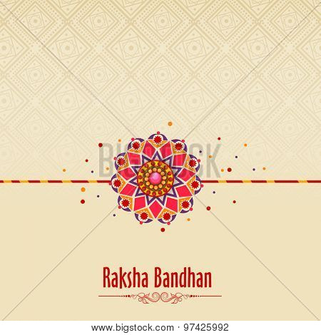 Beautiful traditional rakhi on floral design decorated background for Indian festival of brother and sister love, Happy Raksha Bandhan celebration. poster