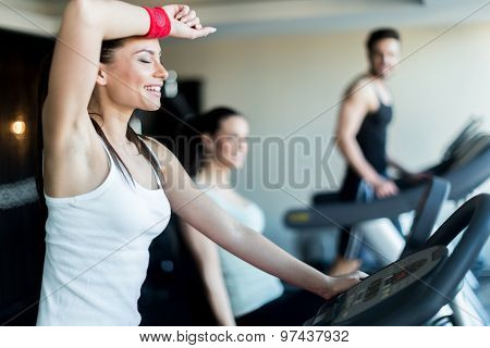 Young, Beautiful Woman Training By Riding A Bicycle In A Gym