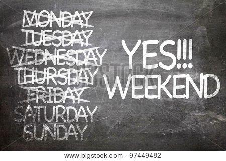 Yes!!! Weekend written on a chalkboard poster