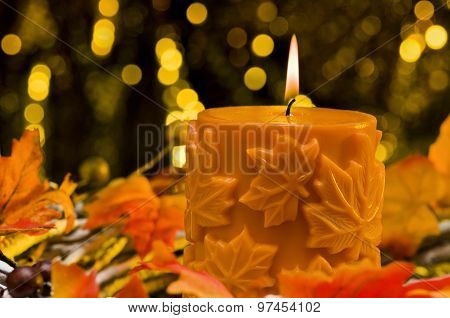 Orange Candle In Autumn Christmas Setting