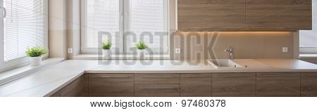 Well-lighted Kitchen With Wooden Furnishing