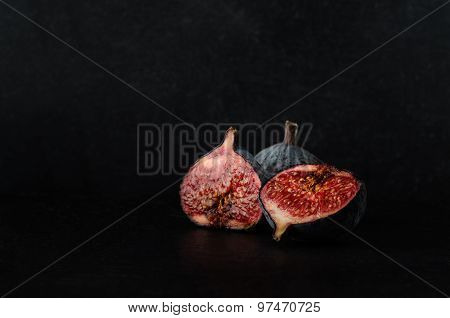 Cut Figs On Black Slate