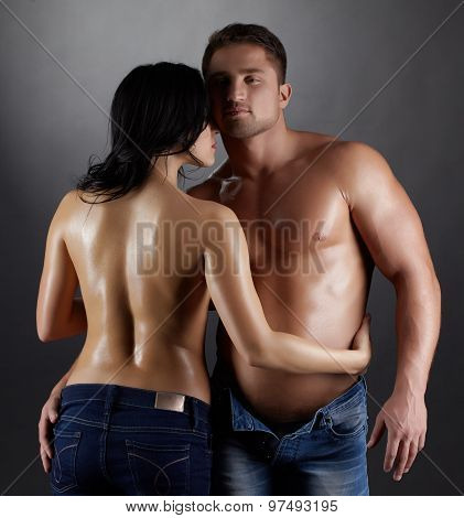 Studio shot of handsome lovers with perfect bodies