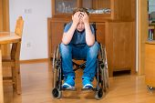 disabled boy in wheelchair at home is sad poster