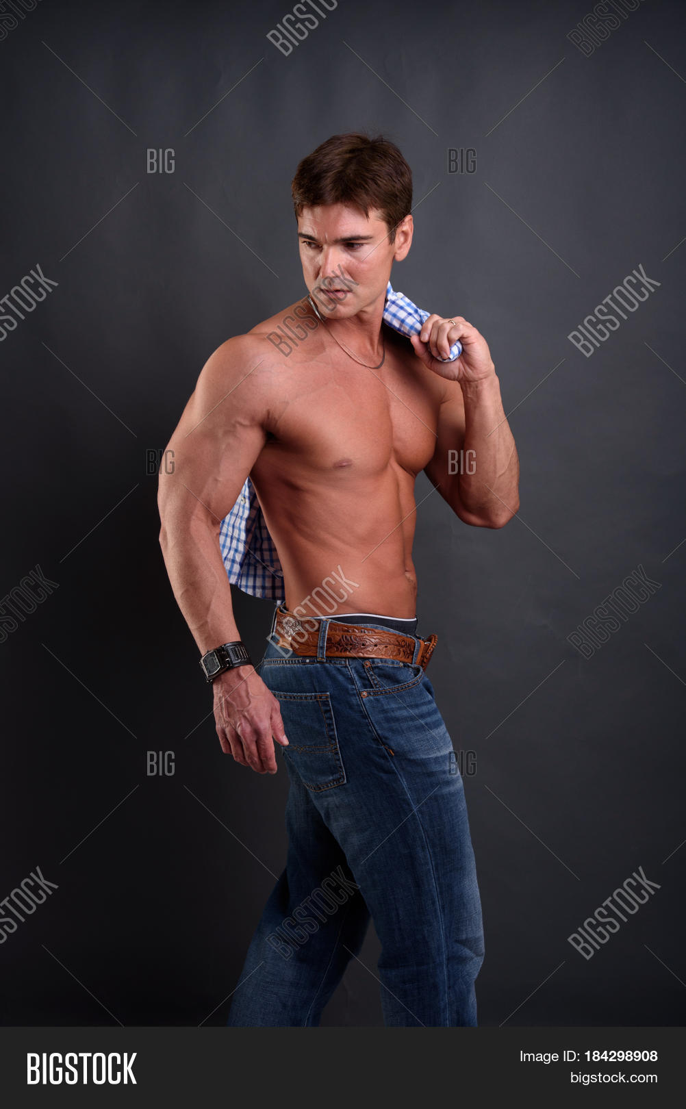 stock finder stud at home young man photo with examining wall