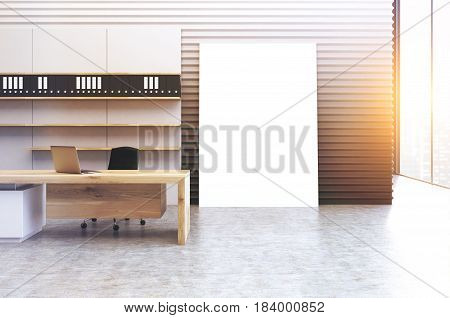 Interior of a clerk office with a gray wall a veritcal poster standing beside it a wooden desk and a bookcase with folders. 3d rendering mock up toned image