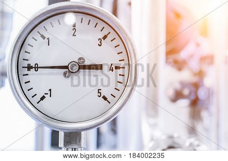 A manometer showing zero pressure in the system. Abstract industrial background.