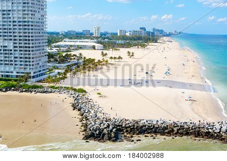 Aerial view of Miami South Beach, Florida, USA. With surfers and peple taking bath and swimming.