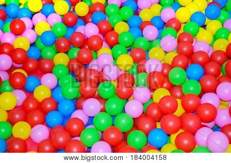 Many multi-colored plastic balls. For children's rooms playgrounds. Background.