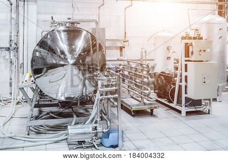 Brewery small capacity. Equipment for beer filtration. Sunlight effect