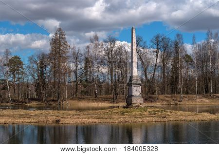 Chesme obelisk on the Gatchina palace park. Leningrad region, Russia. Spring photography.