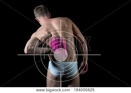 Man Suffers From Backache Standing Over Black Background