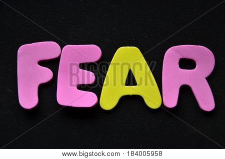 fear word on a  abstract colorful background