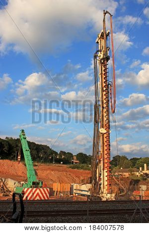 mobile drill and crane on a road construction site