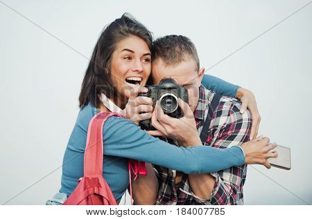 Excited Girl Hugging Handsome Man With Camera