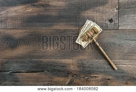 Judges gavel with soundboard and US dollar. Auctioneer hammer on wooden background