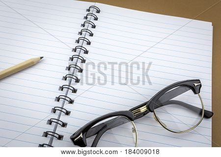Vintage glasses old on a notebook of work
