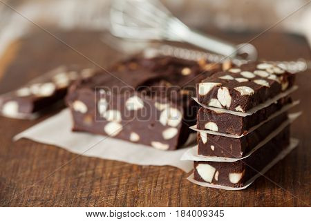 Dark chocolate dessert with almonds copy space