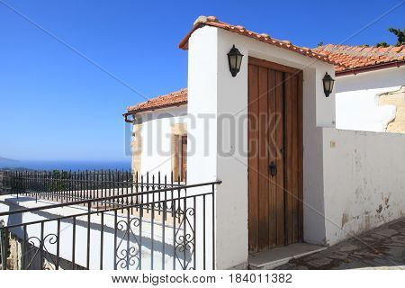 Old wooden door and terrace architecture detail in greek country house, Crete, Greece
