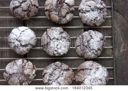 Chocolate crackle cookies with powdered sugar coating, top view