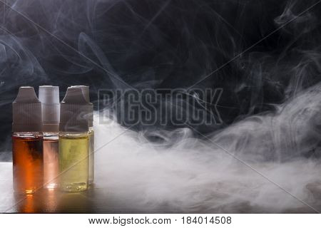 Electronic Cigarette, Vaping Device With E Liquid Background.