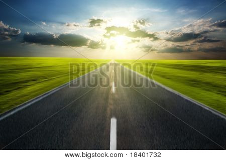 road in motion with clouds