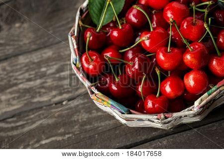 Ripe cherries in basket. View from above with copy space