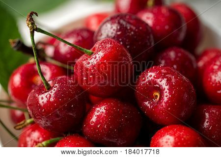 Red, ripe, juicy cherries, water drops, close up background