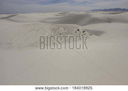 White sand dunes continue on forever into the distance