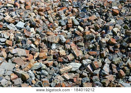 A pile of debris of brick stone and tile in Sunny day